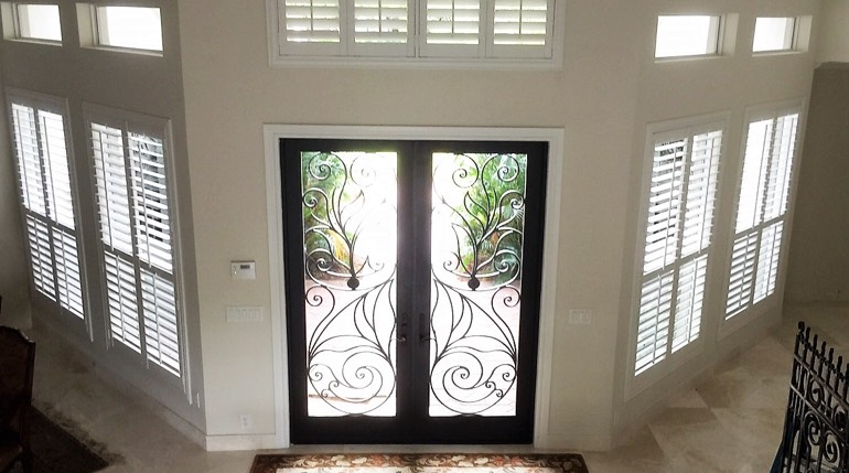 Charlotte foyer with glass doors and interior shutters