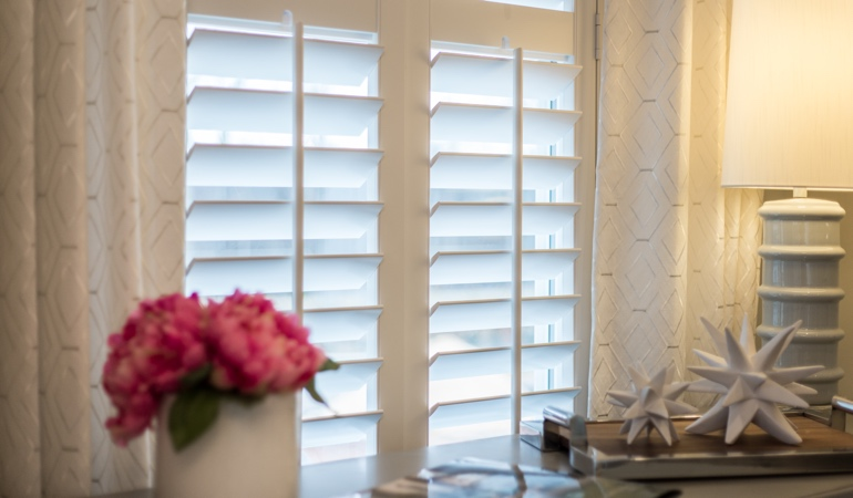 Plantation shutters by flowers in Charlotte