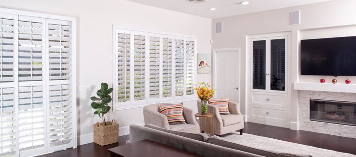 Charlotte living room in white with plantation shutters.