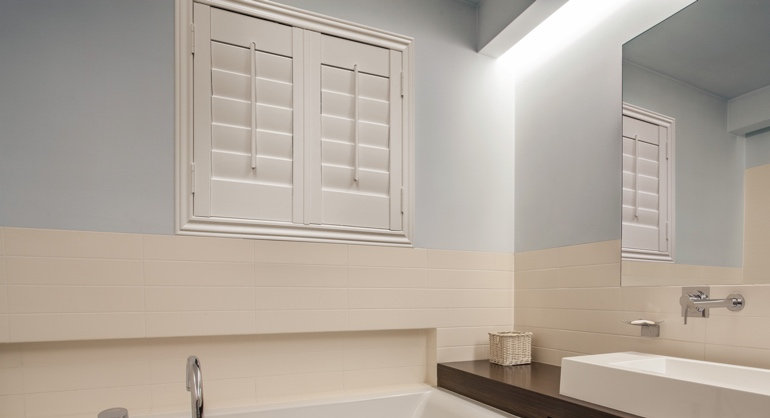 Plantation waterproof shutters in Charlotte bathroom.